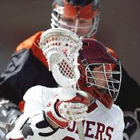 Photo - OU's Cameron Alvarez gets past OSU's Andy Martin during a Bedlam lacrosse game Sunday in Edmond. OU won 15-1. PHOTO BY JOHN CLANTON, THE OKLAHOMAN  John Clanton