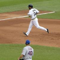Photo - Pittsburgh Pirates' Pedro Alvarez (24) trots around the bases behind New York Mets starting pitcher Bartolo Colon (40) after hitting a two-run home run off him in the fourth inning of the baseball game on Sunday, June 29, 2014, in Pittsburgh. (AP Photo/Keith Srakocic)