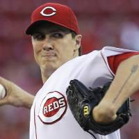 Photo - Cincinnati Reds starting pitcher Homer Bailey throws to a St. Louis Cardinals batter in the first inning of a baseball game, Tuesday, Sept. 3, 2013, in Cincinnati. (AP Photo/Al Behrman)