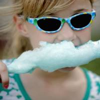 Photo - In this 2010 photo, Madison Howe of Oklahoma City eats cotton candy during a vacation Bible school