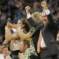 Photo - New Orleans Hornets owner George Shinn reacts after the Hornets scored against the Los Angeles Clippers in overtime of an NBA basketball game in Oklahoma City, Tuesday, April 10, 2007. The Hornets won the game 103-100.  (AP Photo/Sue Ogrocki) ORG XMIT: OKSO107