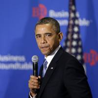 Photo - In this Dec. 5, 2012, photo, President Barack Obama pauses as he speaks about the