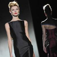 Photo - The Badgley Mischka Fall 2013 collection is modeled during Fashion Week, Tuesday, Feb. 12, 2013, in New York. (AP Photo/Louis Lanzano)