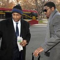 Photo - FILE - In this Nov. 30, 2012, file photo, New Orleans Saints football defensive end Will Smith, left, and linebacker Jonathan Vilma arrive at an attorney's office in Washington, for a hearing on their appeals of bounties suspensions. Former Commissioner Paul Tagliabue, who was appointed to handle a second round of player appeals to the league, has informed all parties he planned to rule by Tuesday, Dec. 11, and his decision could affect whether two current Saints — Jonathan Vilma and Will Smith — get to play out the season. (AP Photo/Cliff Owen, File)