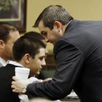 Photo - Trent Mays, 17, left, talks with one of his defense lawyers, Brian Duncan before the start for the fourth day of his and co-defendant 16-year-old Ma'lik Richmond's trial on rape charges in juvenile court on Saturday, March 16, 2013 in Steubenville, Ohio. Mays and Richmond are accused of raping a 16-year-old West Virginia girl in August, 2012. (AP Photo/Keith Srakocic, Pool)