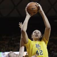Photo - Baylor center Brittney Griner (42) shoots against Kansas State guard Heidi Brown (10) during the first half of an NCAA college basketball game Monday, March 4, 2013, in Arlington, Texas. (AP Photo/LM Otero)