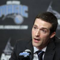 Photo - Rob Hennigan, the new general manager of the Orlando Magic NBA basketball team, speaks during a news conference, Thursday, June 21, 2012, in Orlando, Fla. (AP Photo/John Raoux)  ORG XMIT: FLJR102