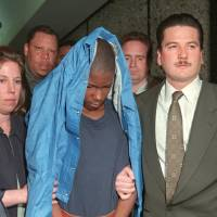 Photo - FILE - In this June 3, 1997 file photo, Malcolm Shabazz, 12, is led from family court in Yonkers, N.Y., in connection with the death of his grandmother, Betty Shabazz, the widow of political activist Malcolm X. U.S. officials say Malcolm Shabazz was killed Thursday, May 10, 2013 in Mexico City. (AP Photo/Kathy Willens, File)