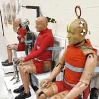 Photo - Aircraft crash test dummies wait their turn at the FAA's Civil Aerospace Medical Institute in Oklahoma City, which is celebrating 50 years.