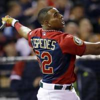 Photo - American League's Yoenis Cespedes, of the Oakland Athletics, hits during the MLB All-Star baseball Home Run Derby, Monday, July 14, 2014, in Minneapolis. (AP Photo/Jeff Roberson)