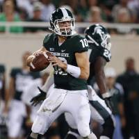 Photo -   FILE - In this Aug. 31, 2012, file photo, Michigan State quarterback Andrew Maxwell looks for a receiver during the third quarter of an NCAA college football game against Boise State in East Lansing, Mich. Maxwell has been waiting a long time to start in a game like this, Saturday night in prime time against Notre Dame, and former Spartans QB Kirk Cousins is confident his replacement is ready for the challenge.(AP Photo/Al Goldis, File0