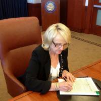 Photo - In this photo provided by by Ariz. Rep. Jeff Dial, Gov. Jan Brewer signs a proclamation calling the Legislature into special session, Tuesday, June 11, 2013, in Phoenix. Brewer acted after weeks of House delays in considering the state budget and her Medicaid expansion proposal. (AP Photo/Courtesy of Jeff Dial)