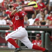 Photo - Cincinnati Reds' Kristopher Negron bats in the fourth inning of a baseball game against the Pittsburgh Pirates, Sunday, July 13, 2014, in Cincinnati. Negron grounded out on the at-bat.  (AP Photo/David Kohl)