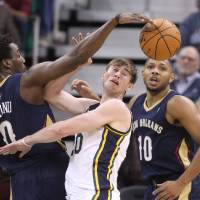 Photo - New Orleans Pelicans' Al-Farouq Aminu (0) steals the ball from Utah Jazz's Gordon Hayward, center, as Pelicans' Eric Gordon (10) watches during the first quarter of an NBA basketball game Wednesday, Nov. 13, 2013, in Salt Lake City. (AP Photo/Rick Bowmer)