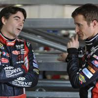 Photo -   Drivers Jeff Gordon, left, and Kasey Kahne confer in the garage area of the Talladega Superspeedway in Talladega, Ala., Friday, Oct. 5, 2012. The drivers were preparing for the Sunday running of the NASCAR Sprint Cup Series auto race. (AP Photo/Rainier Ehrhardt)