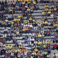 Photo - Empty seats scattered in the stands of the stadium during the group F World Cup soccer match between Iran and Nigeria at the Arena da Baixada in Curitiba, Brazil, Monday, June 16, 2014.  (AP Photo/Martin Meissner)