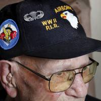 Photo - Jake McNiece, 93, was a paratrooper with 101st Airborne who parachuted behind enemy lines in northern France and led a team of men dubbed the