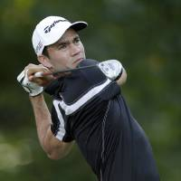 Photo - Camilo Villegas, of Colombia, watches his tee shot on the eighth hole during the first round of the Wyndham Championship golf tournament in Greensboro, N.C., Thursday, Aug. 14, 2014. (AP Photo/Chuck Burton)