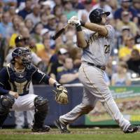 Photo - Pittsburgh Pirates' Pedro Alvarez watches his three-run home run during the fourth inning of a baseball game against the Milwaukee Brewers on Saturday, Aug. 23, 2014, in Milwaukee. (AP Photo/Morry Gash)