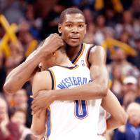 Photo - Kevin Durant and Russell Westbrook celebrate a win over the Jazz. Durant was a little late filling out his NCAA bracket.  Photo by Sarah Phipps, The Oklahoman