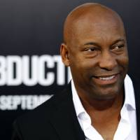 Photo -   FILE - In this Sept. 15, 2011 file photo, director John Singleton arrives at the premiere of