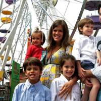 Photo - The Humphreys family right to left: Grant, Jack, Emma, Jenifer, Mary, and Ford from Oklahoma City pose in front of the Pacific Park Ferris Wheel on the Santa Monica Pier on Sunday, May 4, 2008 in Santa Monica, Calif. Grant Humphreys placed the winning bid on eBay $132,400 for the Pacific Wheel with plans to bring it home to Oklahoma City. (AP Photo/Stefano Paltera