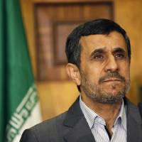 Photo - Iran's President Mahmoud Ahmadinejad listens to a question during a joint news conference with Iraqi Vice President Khudier al-Khuzaie, not shown, in Baghdad, Iraq, Thursday, July 18, 2013. Iran's outgoing President Mahmoud Ahmadinejad has landed in Iraq on his second visit as head of government, highlighting the growing ties between the two Shiite-led neighbors. (AP Photo/ Hadi Mizban, Pool)