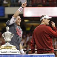Photo - Oklahoma's Trevor Knight and coach Bob Stoops celebrate the 45-31 win over Alabama during the NCAA football BCS Sugar Bowl game between the University of Oklahoma Sooners (OU) and the University of Alabama Crimson Tide (UA) at the Superdome in New Orleans, La., Thursday, Jan. 2, 2014.  .Photo by Chris Landsberger, The Oklahoman