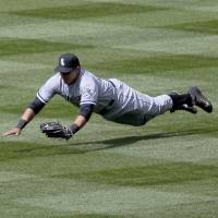 Photo - Chicago White Sox Avisail Garcia (26) makes a diving catch on a drive to right by Colorado Rockies DJ LeMahieu during the fourth inning of a baseball game, Wednesday, April 9, 2014, in Denver. (AP Photo/Barry Gutierrez)