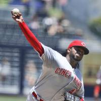 Photo - Cincinnati Reds starting pitcher Johnny Cueto  delivers against the San Diego Padres in the first inning of a baseball game on  Wednesday, July 2, 2014, in San Diego. (AP Photo/Lenny Ignelzi)