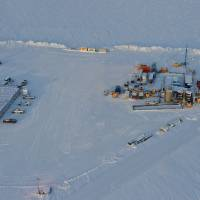 Photo -   In this 2012 photo provided by ConocoPhillips Alaska Inc., a drill rig at Prudhoe Bay on Alaska's North Slope is seen. This rig is testing a method for extracting methane from methane hydrate. The department describes methane hydrate as a lattice of ice that traps methane molecules but does not bind them chemically. A half mile below the ground at Prudhoe Bay, above the vast oil field that helped trigger construction of the trans-Alaska pipeline, a drill rig has tapped what might one day be the next big energy source. The U.S. Department of Energy and industry partners over two winters drilled into a reservoir of methane hydrate, which looks like ice but burns like a candle as warmth from a match releases methane molecules. (AP Photo/ConocoPhillips Alaska Inc., Garth Hannum)