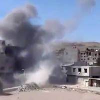 Photo - In this image taken from video obtained from the Shaam News Network, which has been authenticated based on its contents and other AP reporting, smoke rises from buildings due to heavy shelling in Maadamiyeh south of Damascus, Syria, on Thursday, March 14, 2013. (AP Photo/Shaam News Network via AP video)