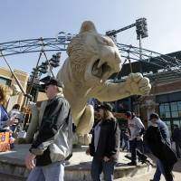 Photo - Baseball fans arrive for a baseball game between the Detroit Tigers and the Kansas City Royals at Comerica Park in Detroit, Monday, March 31, 2014. (AP Photo/Carlos Osorio)