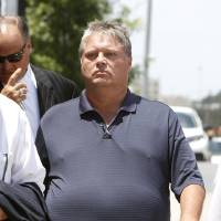 Photo - Gambler Teddy Mitchell arrives Monday at the federal courthouse in Oklahoma City for his guilty plea in an illegal gambling case.  PAUL HELLSTERN - Oklahoman