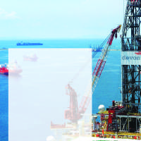 Photo - GRAPHIC: Devon Energy Corp. offshore drilling rig photo with world map showing Devon areas of operation - Canada, United States, Brazil, Russia-Tartarstan, Azerbaijan, China  ORG XMIT: 0911162359573738