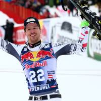 Photo - First placed Austria's Hannes Reichelt celebrates at the end of an alpine ski, men's World Cup downhill, in Kitzbuehel, Austria, Saturday, Jan. 25, 2014. (AP Photo/Giovanni Auletta)