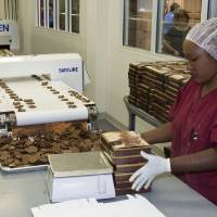 Photo - A woman boxes chocolate at the Chickasaw-owned Bedre chocolate factory in Pauls Valley.  unknown - PROVIDED BY CHICKASAW NATION