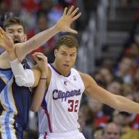 Photo -  Memphis Grizzlies center Marc Gasol, left, of Spain, puts pressure on Los Angeles Clippers forward Blake Griffin as he tries to take a pass during the second half of Game 2 of a first-round NBA basketball playoff series, Monday, April 22, 2013, in Los Angeles. The Clippers won 93-91. (AP Photo/Mark J. Terrill)