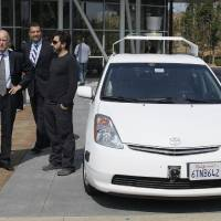Photo -   From left, California Gov. Edmund G Brown Jr., state Senator Alex Padilla and Google co-founder Sergey Brin stand by a driverless car they arrived in at Google headquarters in Mountain View, Calif., Tuesday, Sept. 25, 2012. Brown visited Google to sign legislation for driverless cars. The legislation will open the way for driverless cars in the state. Google, which has been developing autonomous car technology and lobbying for the legislation has a fleet of driverless cars that has logged more than 300,000 miles (482,780 kilometers) of self-driving on California roads. (AP Photo/Eric Risberg)