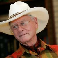 Photo -   In this Thursday, Oct. 9, 2008 photo, actor Larry Hagman listens to a reporter's question while visiting the Southfork Ranch in Parker, Texas, made famous in the television show