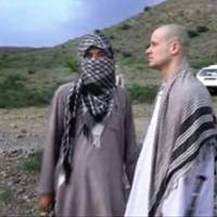Photo - FILE - In this file image taken from video obtained from Voice Of Jihad Website, which has been authenticated based on its contents and other AP reporting, Sgt. Bowe Bergdahl, right, stands with a Taliban fighter in eastern Afghanistan. Bergdahl was freed in a swap in which the U.S. freed five Taliban detainees, a diplomatic victory for the insurgent group. In a belt from Iraq to Pakistan, militants scored a series of successes the past weeks, a sign of their continued power 13 years into the U.S.