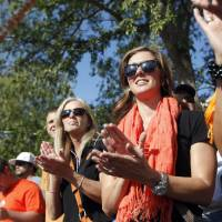 Photo - Melanie Weeden watches the spirit walk before the college football game between the Oklahoma State University Cowboys (OSU) and the University of Arizona Wildcats at Boone Pickens Stadium in Stillwater, Okla., Thursday, Sept. 8, 2011. Photo by Sarah Phipps, The Oklahoman  ORG XMIT: KOD