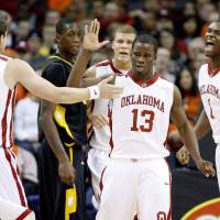 Photo - ALL-COLLEGE TOURNAMENT / CELEBRATE / CELEBRATION: OU's Willie Warren celebrates with Cade Davis, left, Blake Griffin, and Ryan Wright as VCU's Larry Sanders watches during the All-College Classic college basketball game between the University of Oklahoma and Virginia Commonwealth University at the Ford Center in Oklahoma City, Saturday, Dec. 20, 2008. PHOTO BY BRYAN TERRY, THE OKLAHOMAN ORG XMIT: KOD