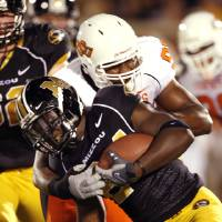 Photo - COLLEGE FOOTBALL: Derek Burton (98) tackles Derrick Washington (24) in the first half as Oklahoma State University Cowboys (OSU) plays the University of Missouri Tigers (MIZZOU) at Faurot Field in Columbia, Mo. on Saturday October 11, 2008.  BY STEVE SISNEY, THE OKLAHOMAN    ORG XMIT: KOD