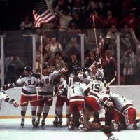 Photo -  UNITED STATES, RUSSIA, DEATH: ** FILE **The U.S. hockey team pounces on goalie Jim Craig after a 4-3 victory against the Soviet Union in the 1980 Olympics IN Lake Placid, N.Y., in this 1980 file photo.  Herb Brooks, who coached the 1980 ``Miracle on Ice'' Olympic hockey team that won the gold medal, died Monday, Aug. 11,  2003  in a car accident, a state official told The Associated Press. He was 66.(AP Photo)