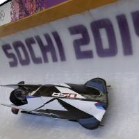 Photo - The USA-1, men's two man bobsled team from the United States, take a turn during a training run at the 2014 Winter Olympics, Wednesday, Feb. 5, 2014, in Krasnaya Polyana, Russia. (AP Photo/Michael Sohn)