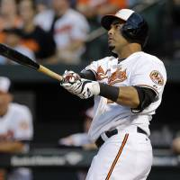 Photo - Baltimore Orioles' Nelson Cruz watches his two-run home run in the first inning of an interleague baseball game against the Cincinnati Reds, Thursday, Sept. 4, 2014, in Baltimore. (AP Photo/Patrick Semansky)