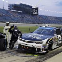 Photo - Brian Scott makes a pit stop during the NASCAR Nationwide series auto race at Chicagoland Speedway in Joliet, Ill., Saturday, July 19, 2014. (AP Photo/Nam Y. Huh)