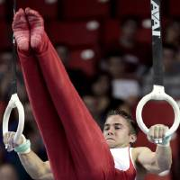 Photo - The University of Oklahoma's Chris Stehl competes in the rings at the event finals of the men's NCAA Men's Gymnastics Championships at the Lloyd Noble Center on Saturday, April 21, 2012, in Norman, Okla.  Photo by Steve Sisney, The Oklahoman