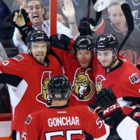 Photo - Ottawa Senators Daniel Alfredsson (11) celebrates with teammates Milan Michalek (9), Sergei Gonchar (55) and Mika Zibanejad (93) in the third period of game four of the Eastern Conference Stanley Cup semi-final NHL hockey action on Sunday May 19, 2013 in Ottawa.  (AP Photo/The Canadian Press, Fred Chartrand)
